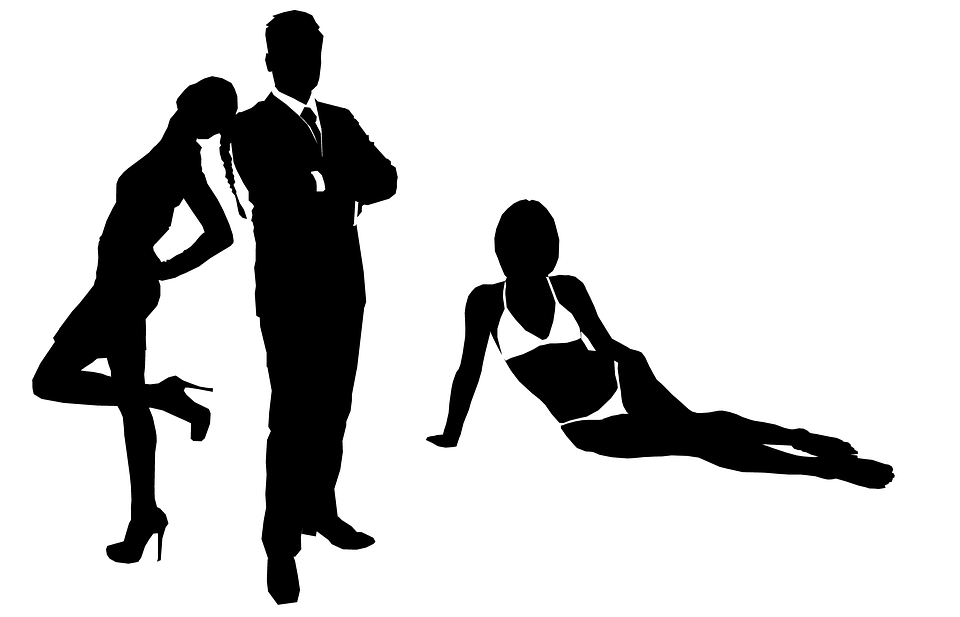 man with two women
