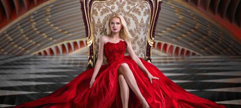 alpha female dressed in red on a throne