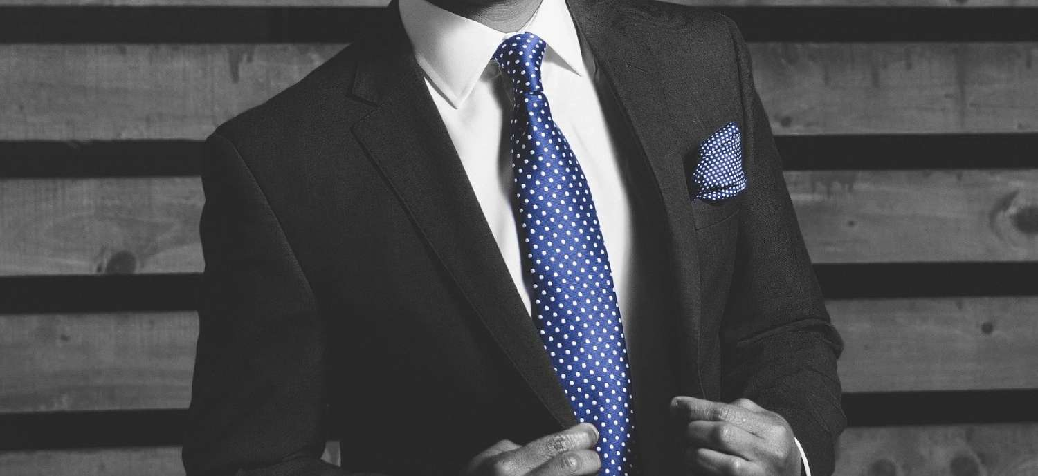 black and white suit with blue tie