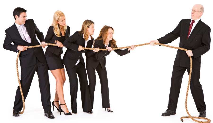 symbol of work conflict of interest with tug of war