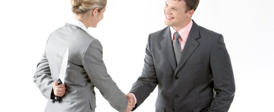 picture of a smiling woman shaking hands while hiding a knife