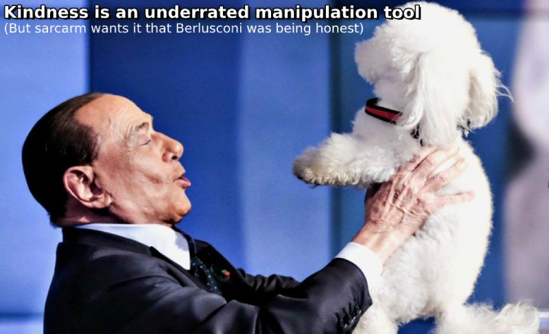Berlusconi faking kindness with a dog