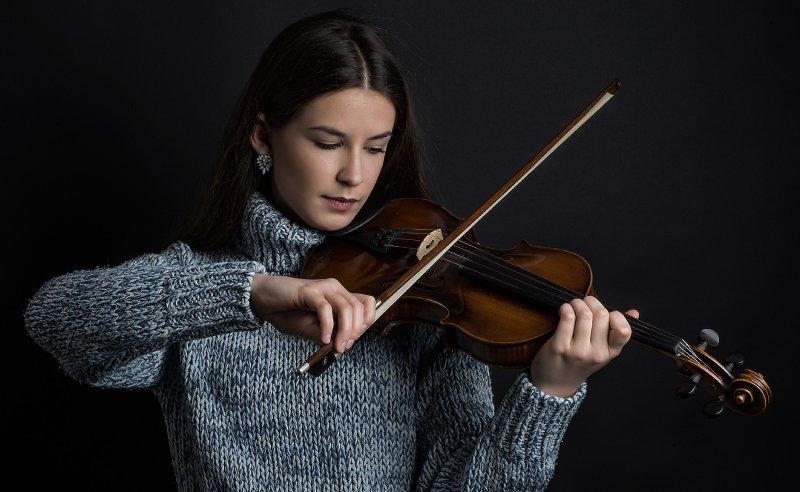 feminine girl playing violin