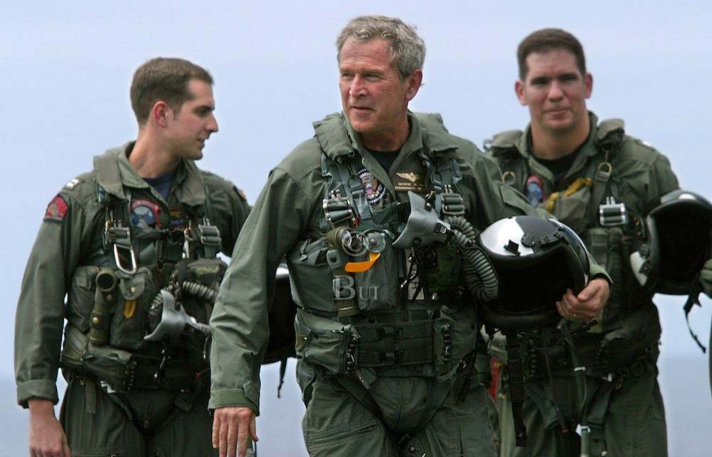 george bush on a flying suit