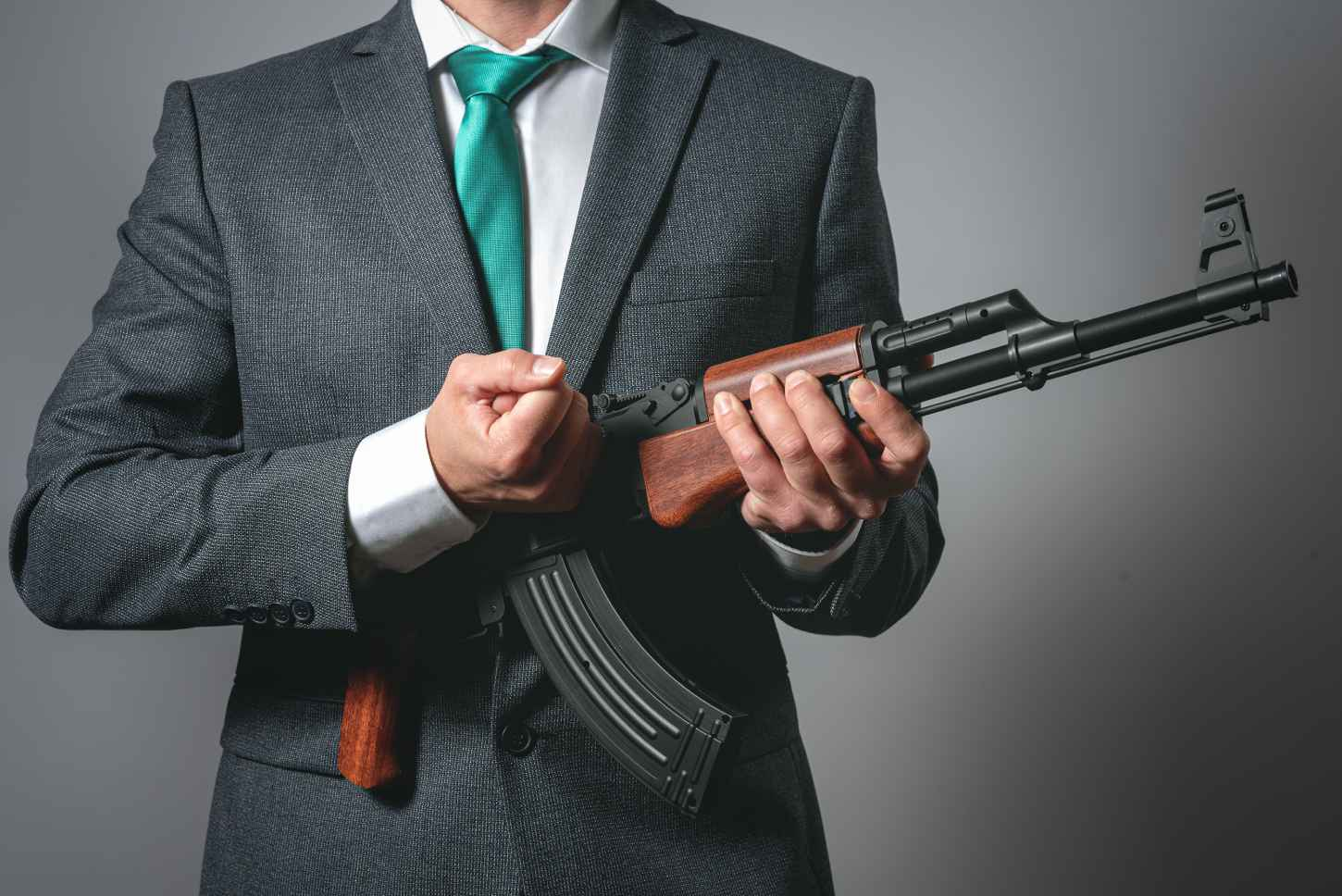 businessman loading an automatic weapon