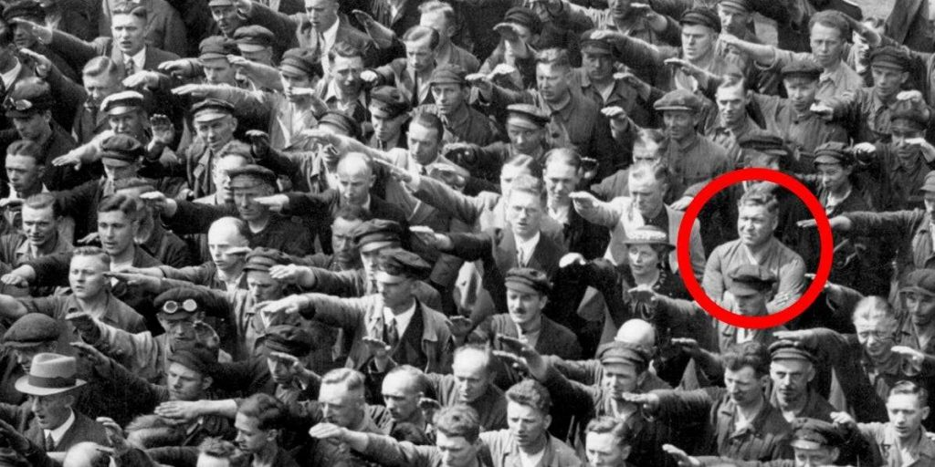 man in crowd refused to do nazi salute