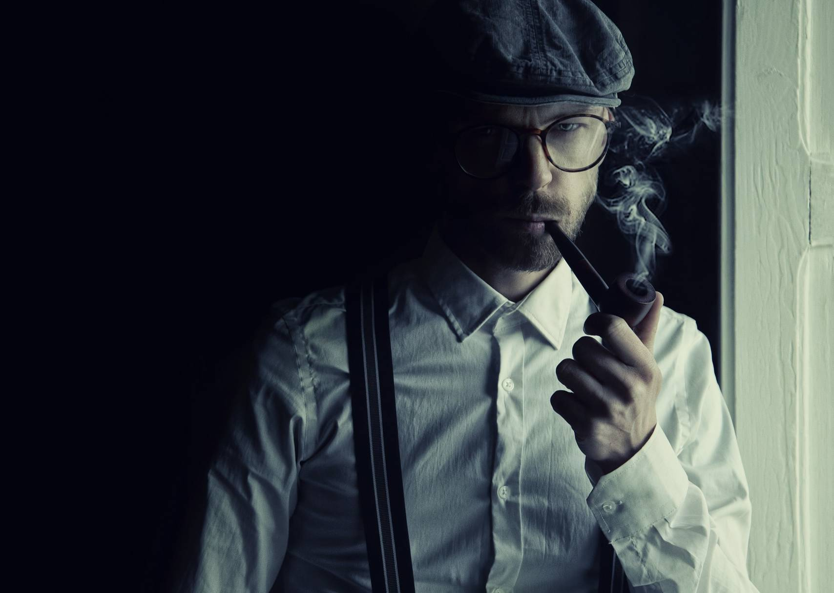 intellectual man smoking a pipe
