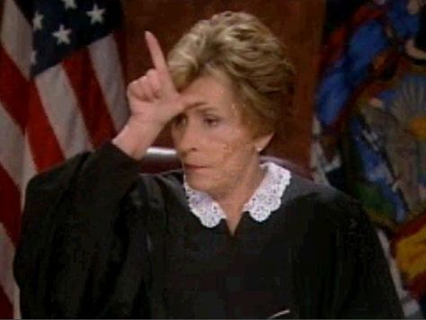 """judge judy with an """"L"""" sign"""