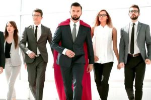 concept of leadership with man walking with a red cape