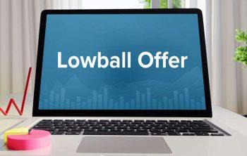 lowball offer written on open laptop