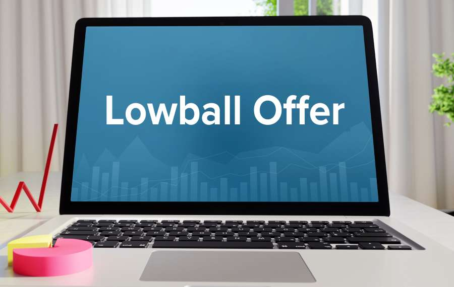 lowball offer written on open laptop