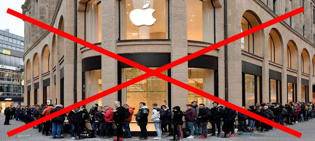 people stand in the queue to buy apple device