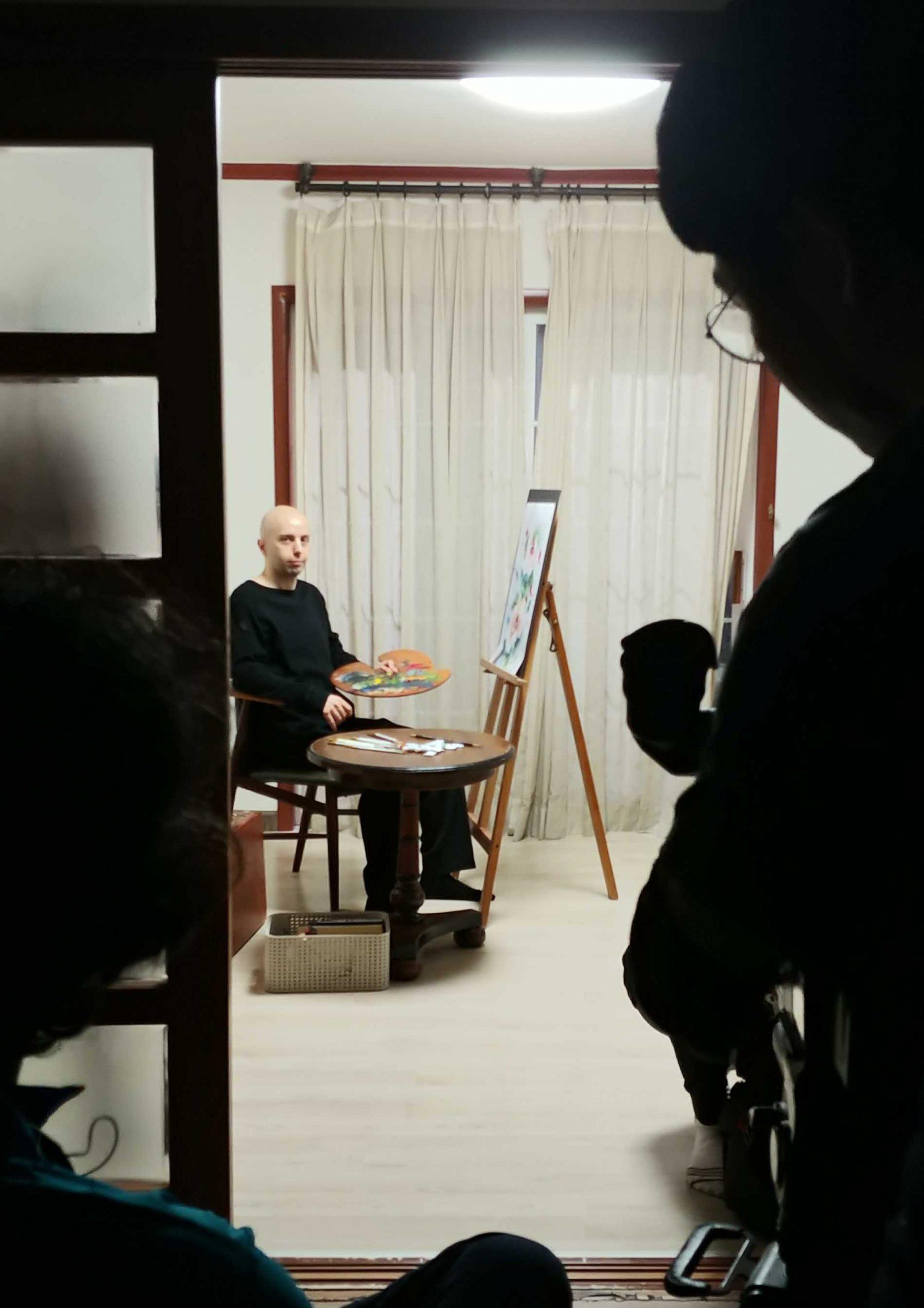 lucio buffalmano on set, between takes