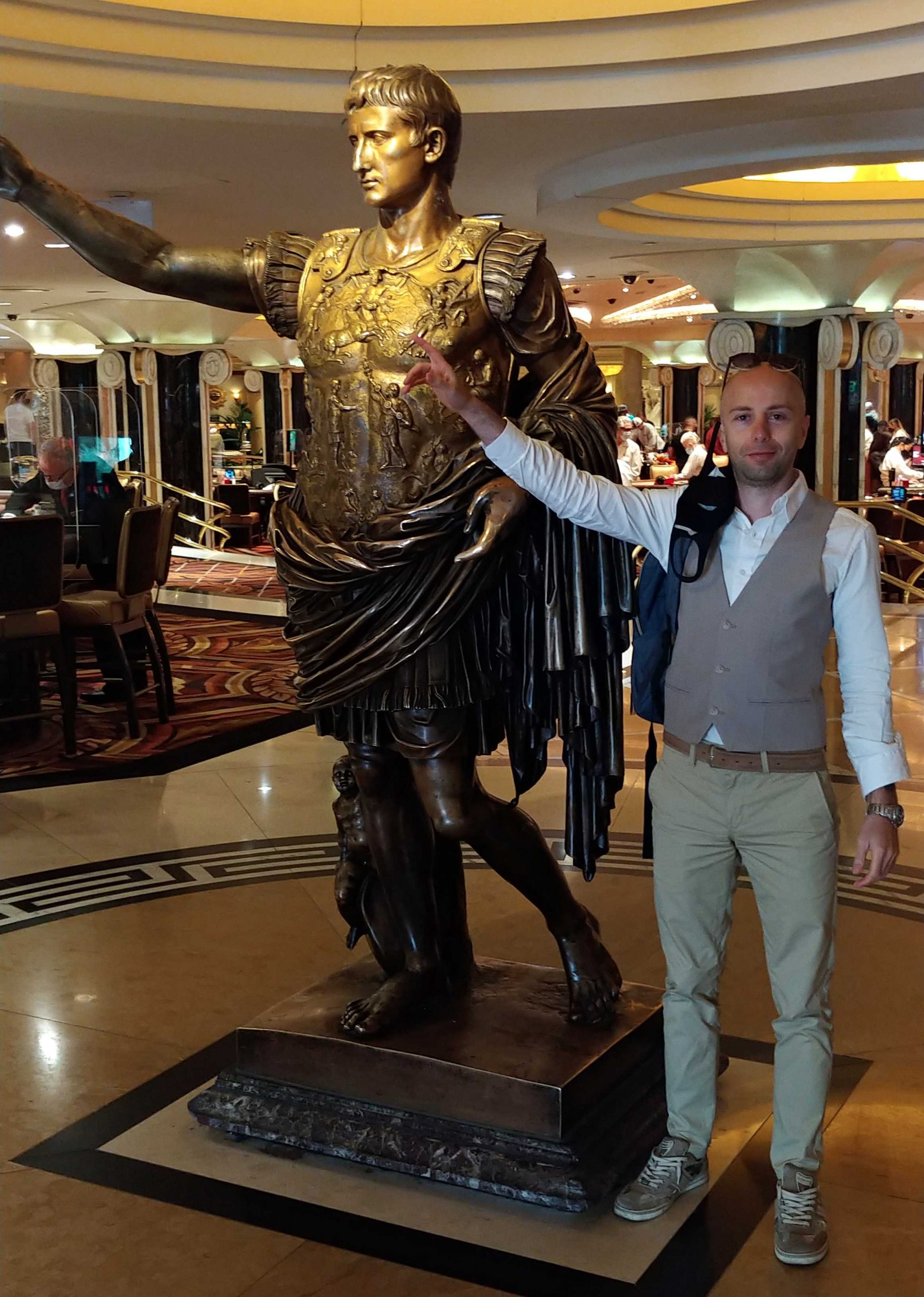 lucio buffalmano next to Caesar statue