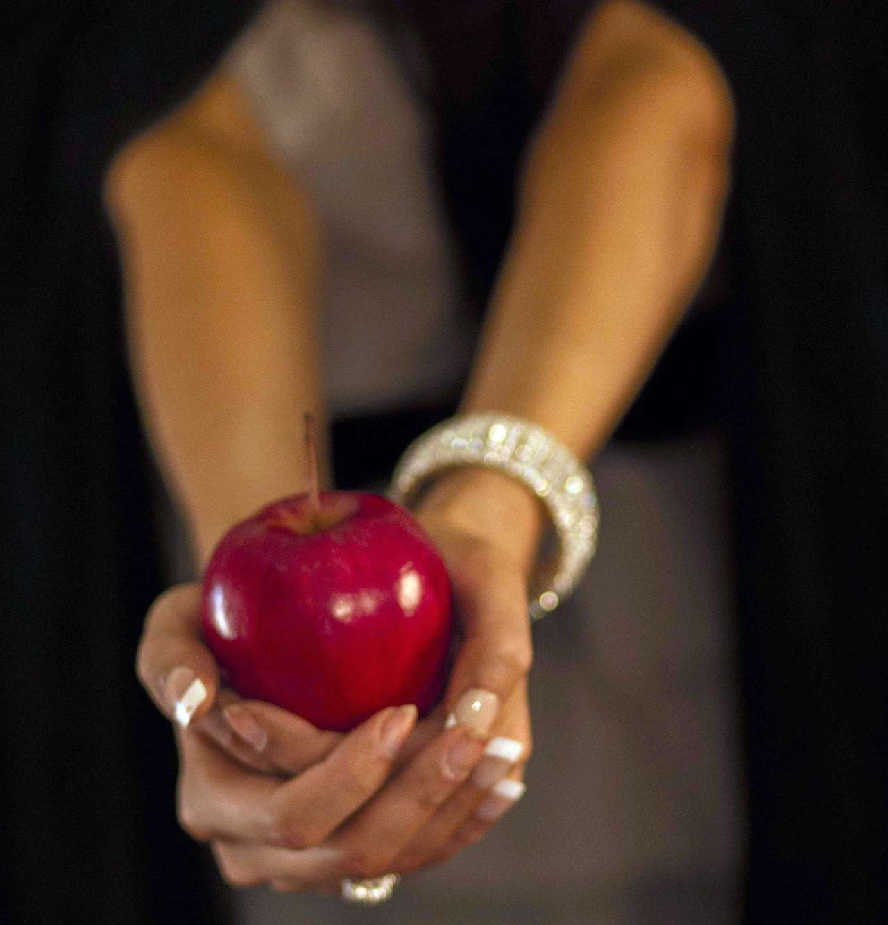 woman holds a red apple