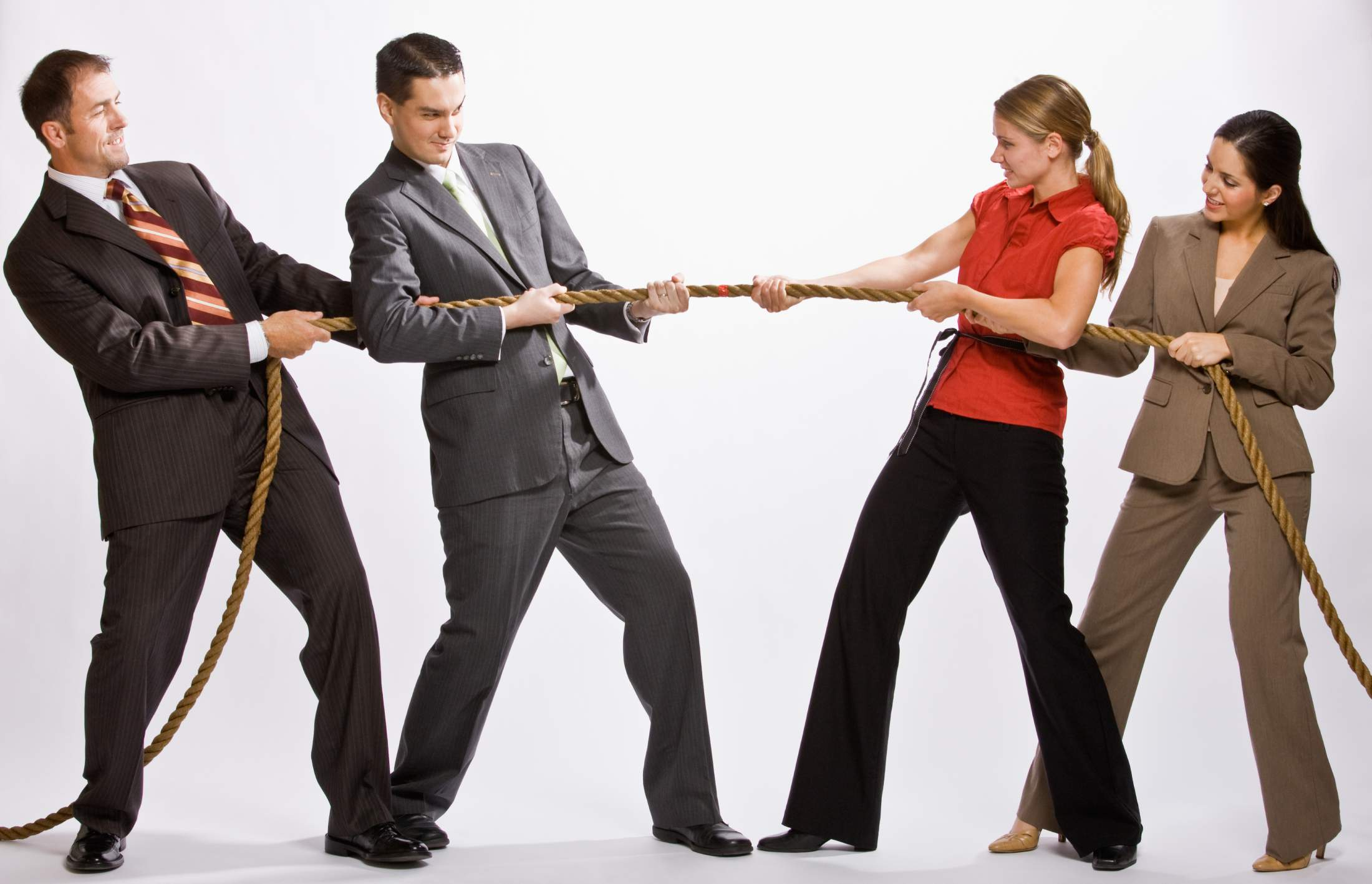 businessmen and businesswomen tug of war