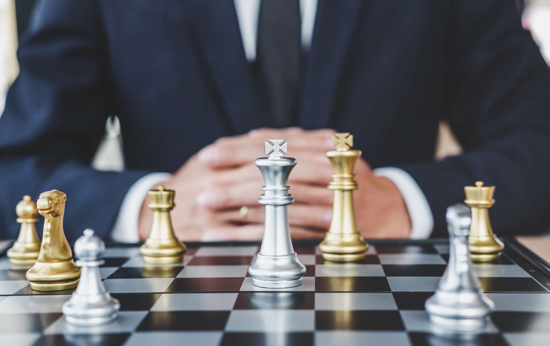 businessman in front of a chessboard