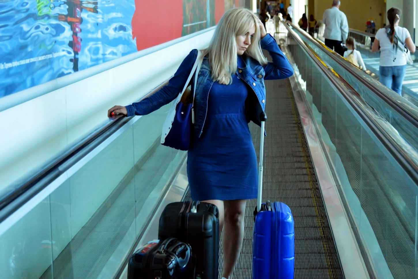 woman traveling with bags