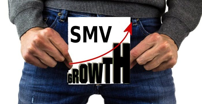 men holdin an SMV card on his crotch