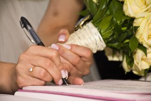 bride signs a prenup