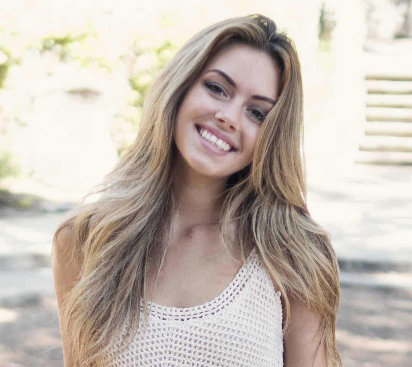 woman smiling and lookingly girly